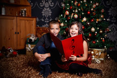 Little children singing a song. At Christmas Eve Royalty Free Stock Images