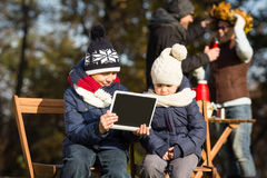 Little children sitting all together with tablet PC royalty free stock image