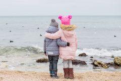 Little children stand in an embrace on the beach Royalty Free Stock Photos