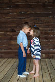 A little children stand and touch nose to nose. A little brother and little sister stand and touch nose to nose each other Royalty Free Stock Photo