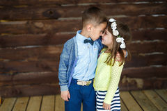 Little children stand and touch nose to nose. Portrait of A little brother and little sister stand and touch nose to nose each other Royalty Free Stock Photo