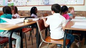 Little children talking in classroom. In elementary school stock video footage
