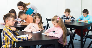 Little children with teacher in classroom. Little children with teacher at the classroom Royalty Free Stock Photo