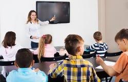 Little children with teacher in classroom. Little children with teacher at classroom Stock Photo
