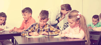 Little children with teacher in classroom. Little children with their teacher at classroom Stock Photos