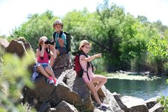 Little children with traveling gear outdoors. Summer camp royalty free stock photography