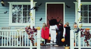 Little children trick or treating royalty free stock photo