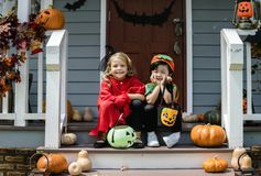 Little children trick or treating on Halloween stock image