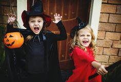 Little children trick or treating on Halloween stock image