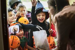 Little children trick or treating on Halloween royalty free stock image