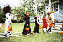 Little children trick or treating in Halloween royalty free stock photo