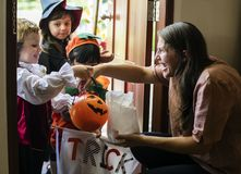 Little children trick or treating on Halloween royalty free stock photography