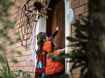 Little children trick or treating on Halloween stock photography