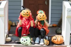 Little children trick or treating on Halloween. Ttle children trick or treating on Halloween royalty free stock images