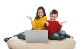 Little children using video chat on laptop royalty free stock photos
