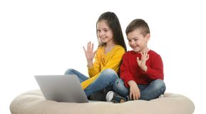 Little children using video chat on laptop stock image