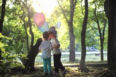 Little children are walking in a park royalty free stock photos