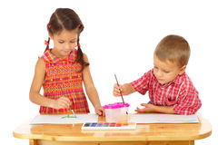 Little children with watercolor paintings Stock Photos