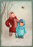 Little children in winter forest Royalty Free Stock Image