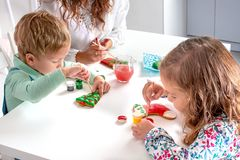 Free Little Children With A Nanny  To Prepare For Christmas.  They Sit At The Table In The Room Stock Photos - 163182563