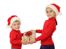 Little children with yellow Christmas gift box Stock Photo