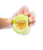 Little childs hand holding an unripe green apple Royalty Free Stock Photo