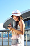 Little Chinese Asian girl with phone. Little Chinese Asian Tourist Girl enjoying her holiday under the sun royalty free stock photography