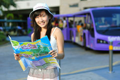 Little Chinese Asian Tourist Girl with map. Little Chinese Asian Tourist Girl enjoying her holiday under the sun royalty free stock photo