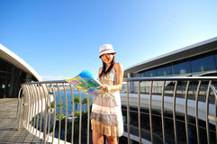 Little Chinese Asian Tourist Girl with map 4 Stock Photos