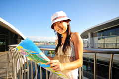 Little Chinese Asian Tourist Girl with map 5 stock photos