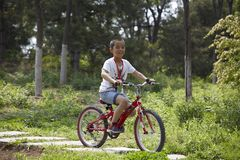 Little Chinese boy riding mountain bike Stock Images