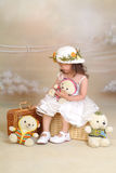 A little chinese girl. With toys Stock Images