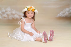 A little chinese girl. A little beautiful chinese girl seat on the flood Stock Photo