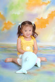 A little chinese girl. With toys Stock Photo