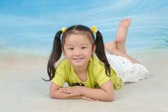 A little chinese girl. With toys Stock Photos