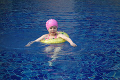 A little chinese girl  swimming Royalty Free Stock Image