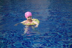 A little chinese girl  swimming Royalty Free Stock Photos