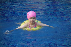 A little chinese girl  swimming Stock Image