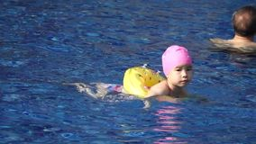 A little chinese girl swimming Royalty Free Stock Photo