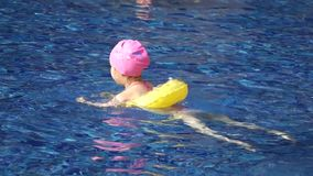 A little chinese girl swimming stock footage