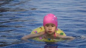 A little chinese girl swimming stock video