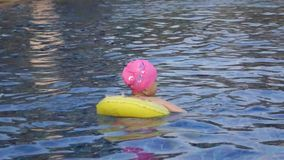 A little chinese girl swimming stock video footage