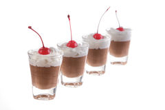 Little chocolate mousse. Chocolate mousse in little glass on isolate white background Stock Photo