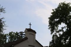 Little christian cross on the top of a church close up Royalty Free Stock Images