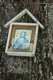 Little Christian Icon on Old Tree. Royalty Free Stock Images