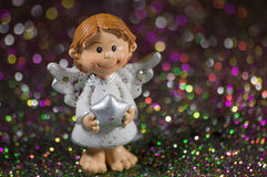 Little Christmas angel with a silver star Stock Photos