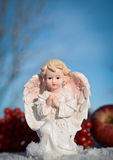Little christmas angel in the snow and blue sky. One little christmas angel in the snow and blue sky Royalty Free Stock Image