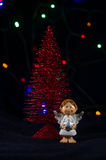 Little Christmas angel with a star. Stock Photo