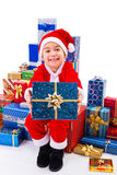 Little Christmas boy along gifts Stock Photography