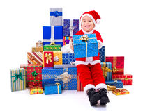 Little Christmas boy along gifts Royalty Free Stock Photo